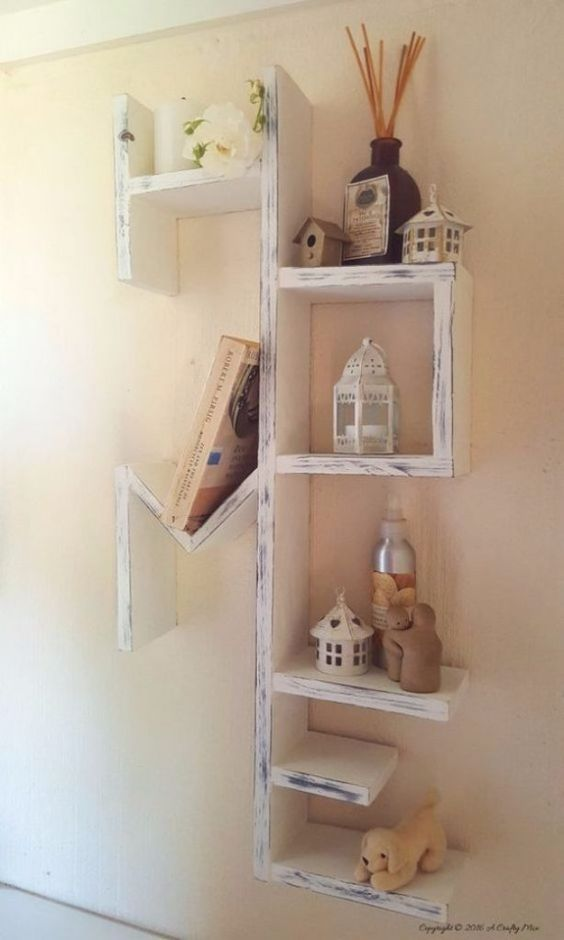 a whitewashed pallet shelving unit with many tiers is a chic idea to rock in any room