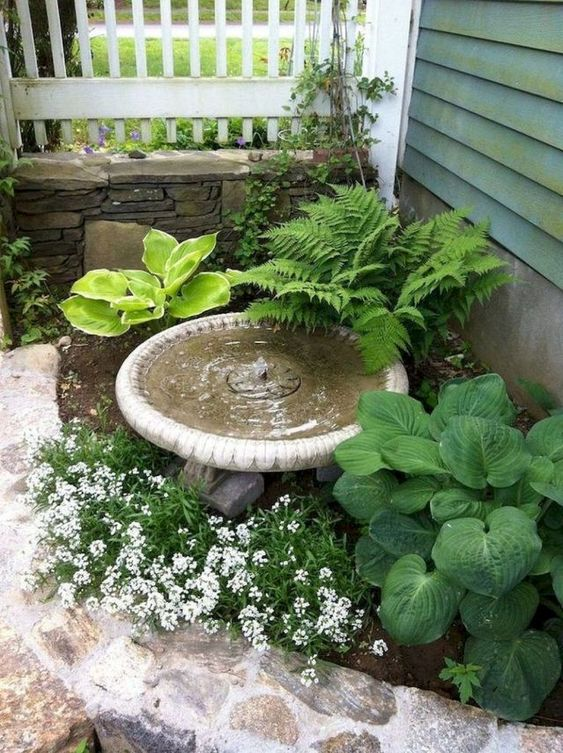 a front yard water features immediately harmonizes the space and brings a calming soung of falling water