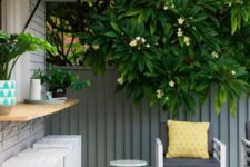 15 a garage-style window with a wooden windowsill outdoors, white plank stools and a grey wooden deck