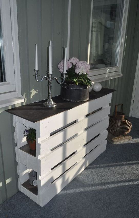 a chic pallet console table of two pieces painted white and a black tabletop looks cool and elegant