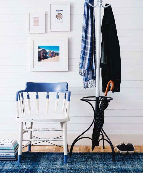 a color block and leg-dipped navy and white chair is ideal for a beach-inspired entryway