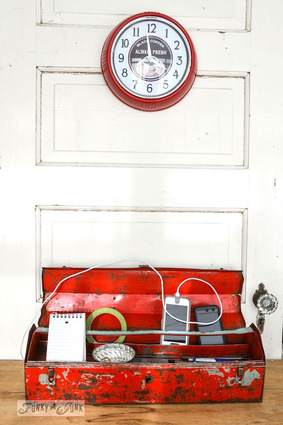 a rusty and shabby chic red box turned into a charging station cna be used in any room