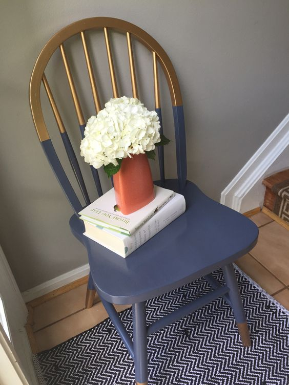 a gilded and navy color block chair looks much more modern and bold with this technique