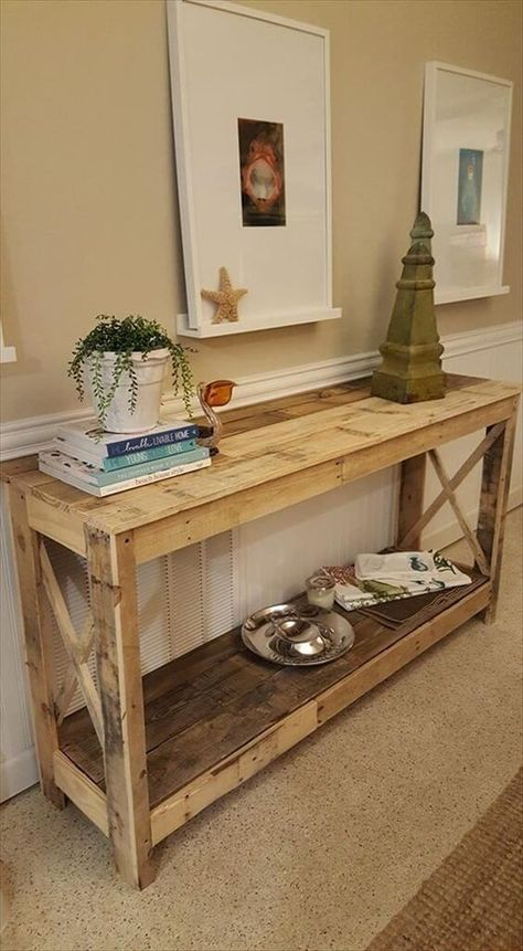 a large rustic console of pallet wood with a shelf and planks on the sides is ideal for a vintage space