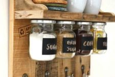 17 a stained rustic meets industrial rack with storage space, with jars on magnets and hooks for cups