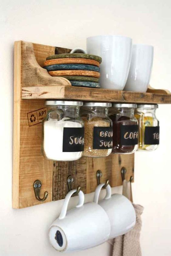 a stained rustic meets industrial rack with storage space, with jars on magnets and hooks for cups