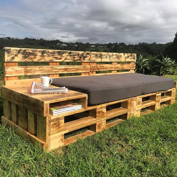 an outdoor daybed with a storage unit on one end and a back is a great idea and a simple DIY project