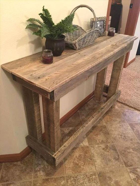 a large rustic pallet console is a cool DIY project, and you may add a shelf underneath for more storage