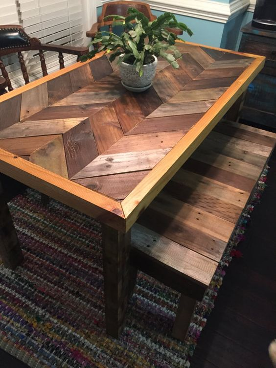 a rustic dining table with a chevron pattern pallet wood tabletop and slatted benches, with minimal staining