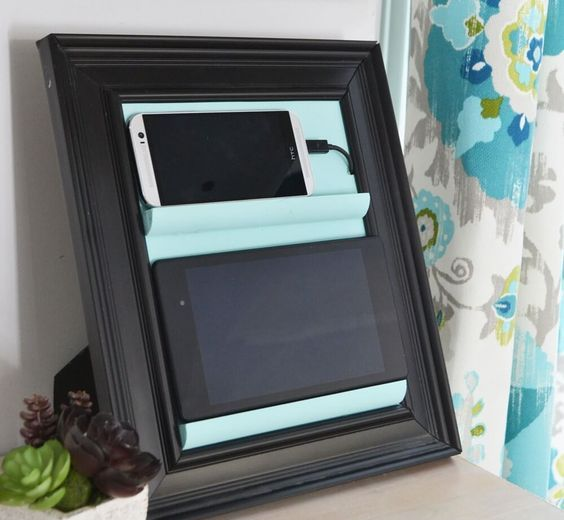 a small and comfortable charging station of a frame and some ledges is a cool idea for every space
