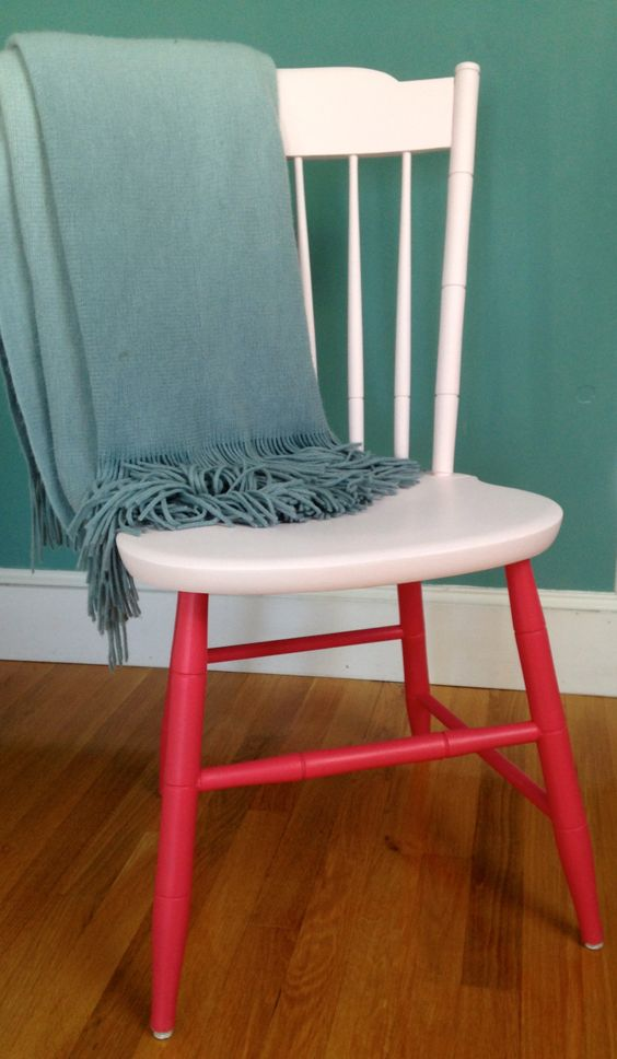 a stylish two tone chair in creamy and red looks catchy and playful and will add color to any space