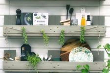 18 a trio of simple shelves in the kitchen to store eveyrthing you may need, hang stuff and even add greenery – built of pallet wood painted grey