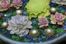 18 accent your succulents in the containers with colorful glass pebbles like these ones