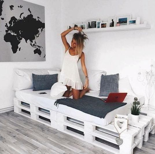 finish off your cozy nook for reading and chilling with a whitewashed pallet bed and soem storage space