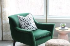 19 a green velvet chair with a polka dot pillow, a woven ottoman, a fur rug and a metal floor lamp