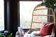 20 a hanging rattan birdcage chair with pillows, a blanket, a fur throw is a gorgeous base for a reading nook