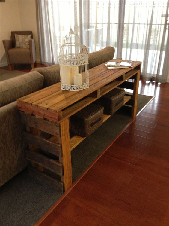 a rich-stained pallet console table with an additional shelf is a great piece to place behind your sofa