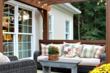 20 potted blooms and greenery and a nasket for storage are ideal to accessorize a rustic deck