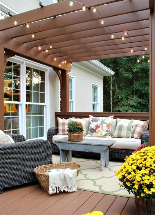 potted blooms and greenery and a nasket for storage are ideal to accessorize a rustic deck