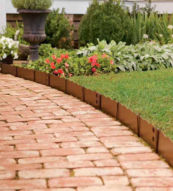 scallop garden bed edging and red bricks are a cool and very bright combo with high durability