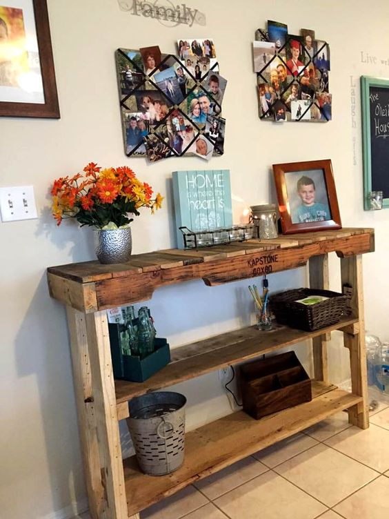 a rustic stained pallet console table with several shelves brigns enough storage space to the entryway