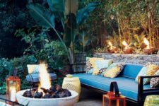 21 colorful pillows, red lanterns with candles, perforated tables and a large fire bowl to create an ambience