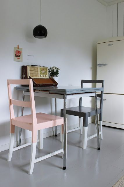 painted color block chairs in graphite grey, pink and dove grey for a retro dining space