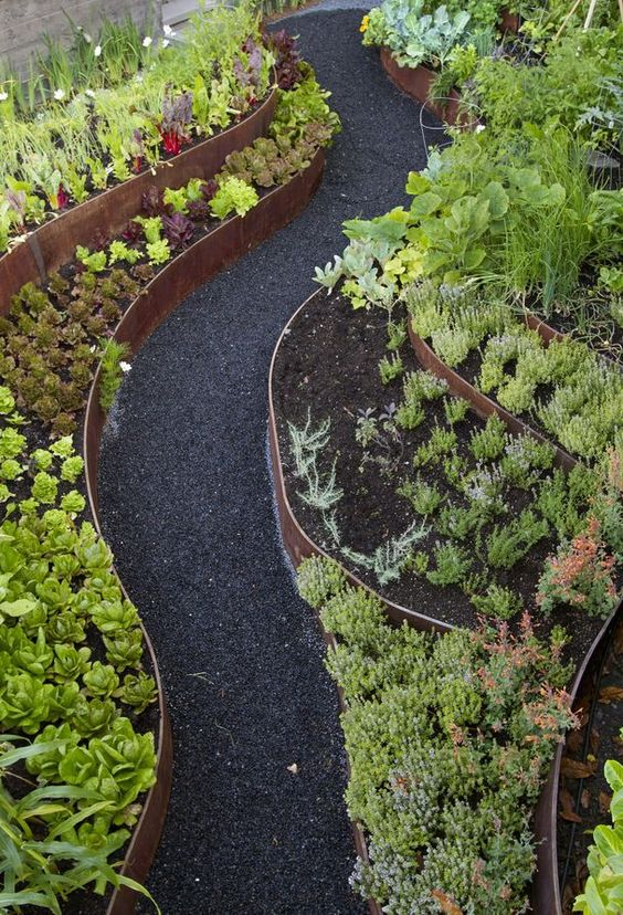thin patin metal ribbons look amazing with greenery, cacti and succulents and black pathways