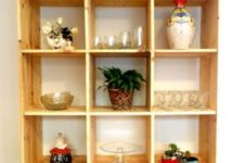 22 a mobile storage unit build of pallet wood stained light is a cool unit for a kitchen or a dining space – here you'll see glasses and pots stored