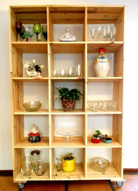 a mobile storage unit build of pallet wood stained light is a cool unit for a kitchen or a dining space   here you'll see glasses and pots stored