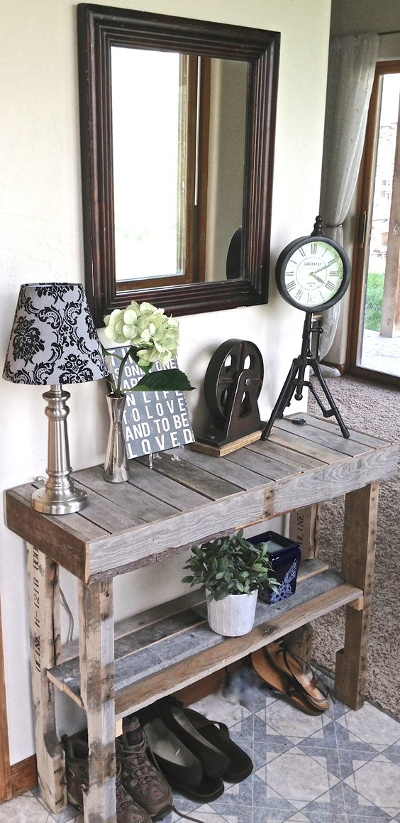 a rustic vintage pallet console table left unstained features a raised shelf, so you may place your shoes under it