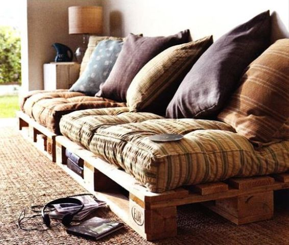 a welcoming pallet daybed with storage space, colorful textiles and pillows