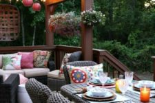 22 bright lanterns and bright and printed pillows are a must to create an ambience on the deck