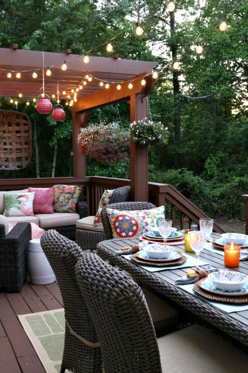 bright lanterns and bright and printed pillows are a must to create an ambience on the deck