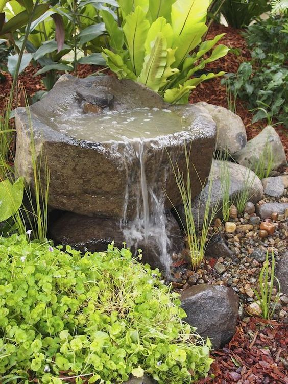rock gardens are ideal for any garden, they are very natural and that water sound is relaxing