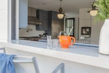 23 a roll up window with a white countertop and comfy chairs is ideal to have an outdoor meal