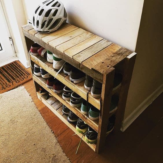a simple rustic shoe rack built of pallet wood features several tiers to accommodate all your shoes, the piec ewill fit even a small entryway