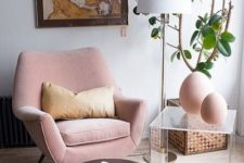 24  a blush mid-century modern chair with curves and angles is a cool piece, and a brown ottoman contrasts it