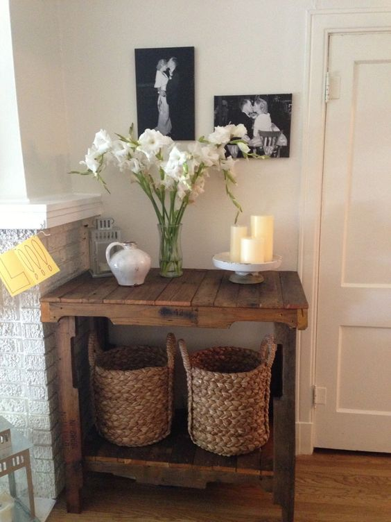 a simple rustic pallet console stained in a rich color perfectly fits a small awkward nook