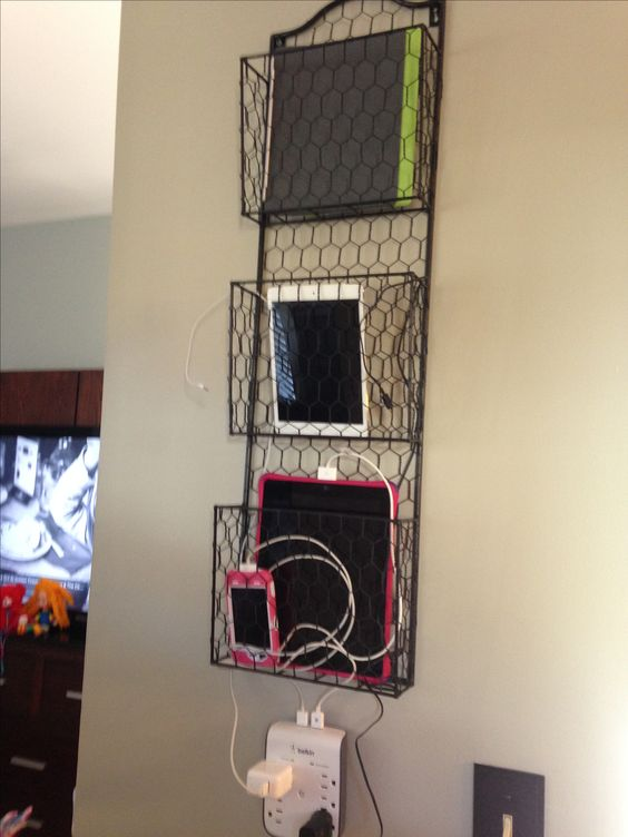 a wore basket hanging on the wall is ideal to charge your tablets and phones and can be hung anywhere