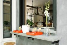 24 an oversized roll up window and a small concrete tabletop and metal and wood stools for an industrial feel