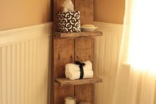 25 a sleek bathroom shelf with several tiers for bathroom stuff and towels is a stylish idea for a rustic bathroom