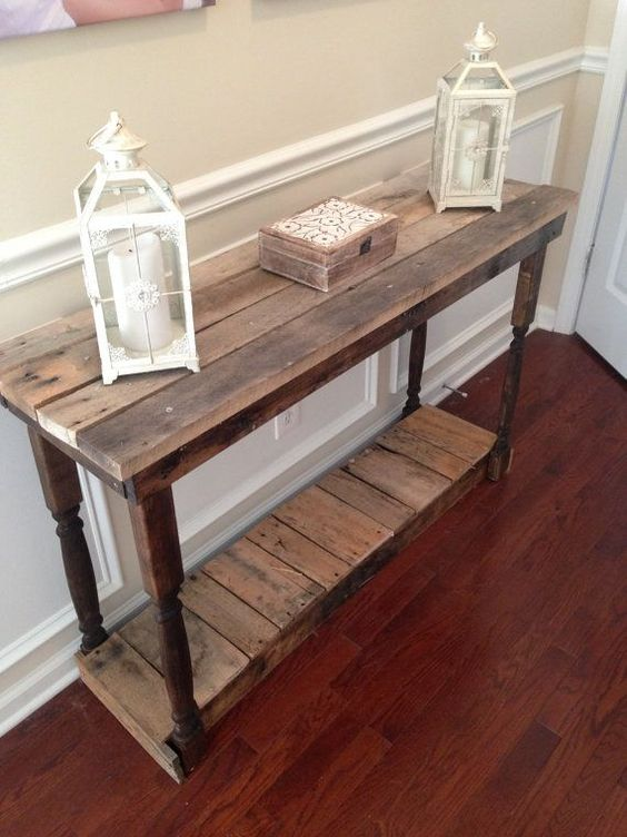 a vintage farmhouse console built of pallet wood and exquisite legs taken from another furniture piece