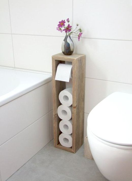 a sleek toilet paper roll holder with some storage space on top is a great for a bathroom with lack of space