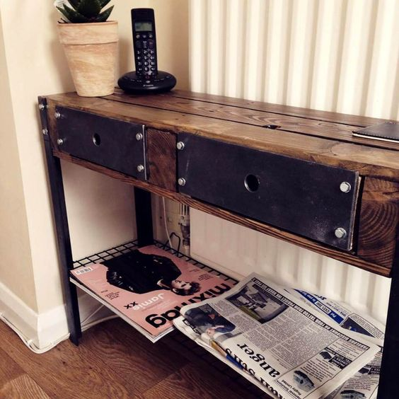 a vintage industrial console table built of pallets and metal details gives much storage space