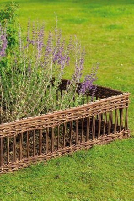 chic and delicate woven basket garden bed edging for a subtle rustic look