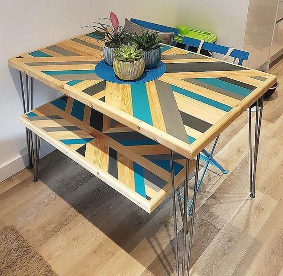 make your pallet dining table bold adding a pattern and some colors to it, here you'll also see matching benches