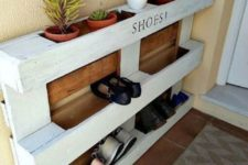 27 an easy pallet shoe rack in white and with stained parts features shoe storage and storage for pots with succulents