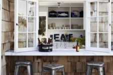 28 a usual window, a white tabletop and metal chairs make up a cool and bold industrial meal space