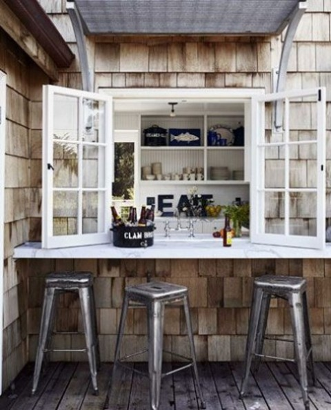 a usual window, a white tabletop and metal chairs make up a cool and bold industrial meal space